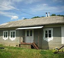 Atenție, preț nou! Se vinde casă pe 76 ari îngrădiți, zonă pitorească.