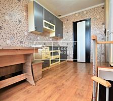 Apartament modern în două nivele situat într-un bloc secundar în ...