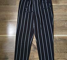 Продам фирменные брюки, немного торчат нитки
