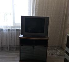 Продам телевизор с тумбочкой.