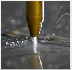 Компьютерная резка металла струей воды, стекла, камня, плитки.