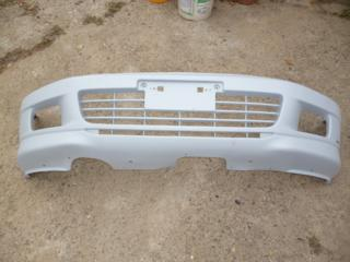 Передний бампер Mitsubishi Galant 1996-2000 г.