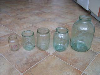"""Стеклобанки б. у. Бутыля пластиковые 9-литровые б. у. от воды """"Ом""""."""