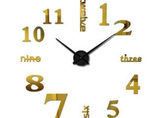 Большие золотистые настенные часы, как на первом фото