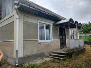 Дом с участком, подвалом и гаражом