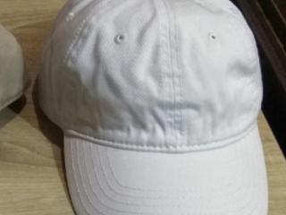 Продам новую кепку и шапку