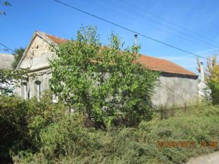 Продам участок с ветхим строением в Матвеевке.