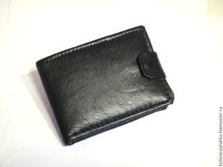 Утерян черный кошелек