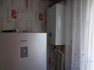 Apartament două odăi separate de mijloc, încălzire autonomă Cartierul 7