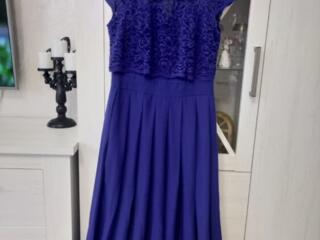 Платья размер 48, блузки размер 46.