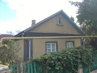 Дом в районе Мечникова, с гаражом и участком.